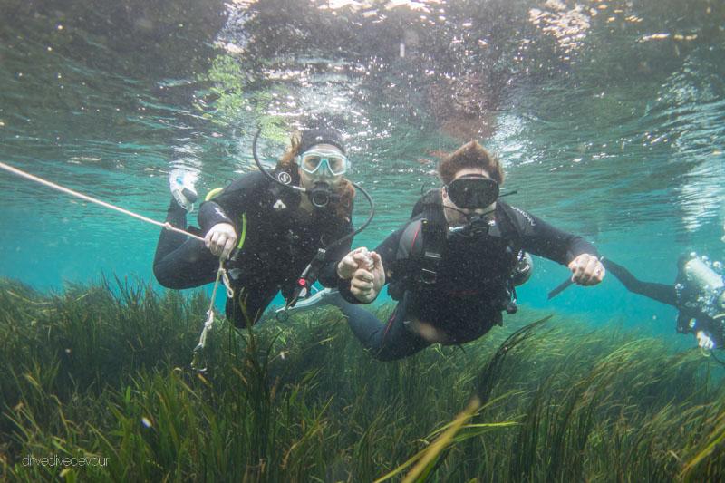 Drive Dive Devour -Kerensa and Brandon scuba diving in Rainbow River in Florida