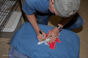 The owner signing my Valhalla shirt.